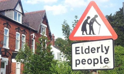 A triangle road sign reading 'elderly people'.